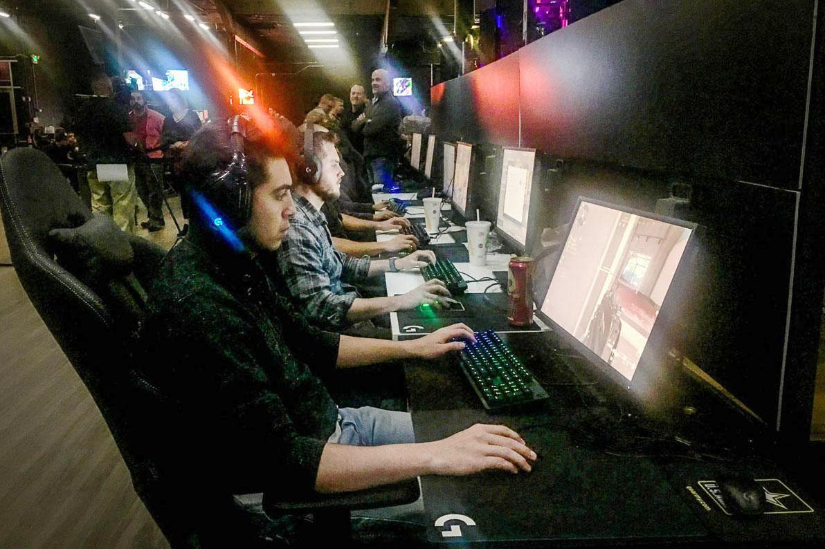 Andrew Garcia, 22, plays 'Call of Duty: Modern Warfare' at the Localhost Denver Arena during an October Army recruiting event. Photo: Taylor Allen, Colorado Public Radio